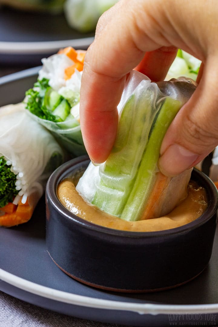 Dipping tofu spring roll to the homemade peanut sauce