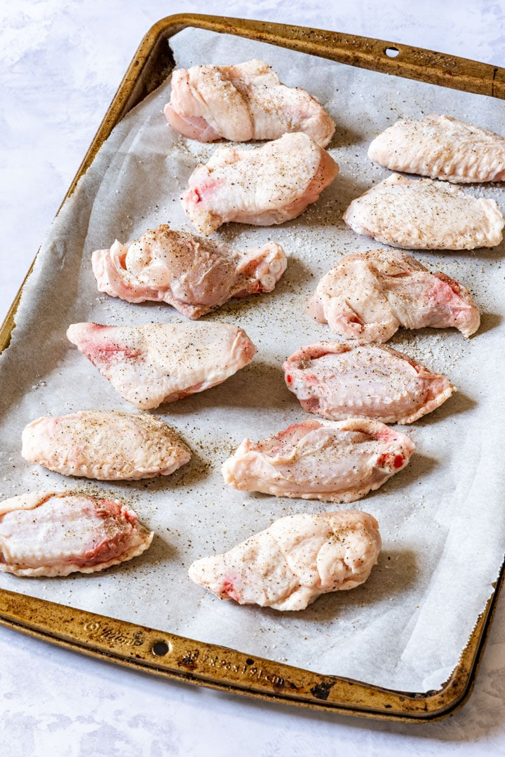 Uncooked chicken wings on the baking tray