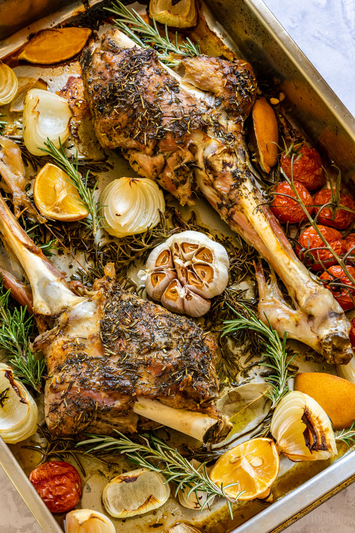 Oven roasted legs of lamb on the baking tray