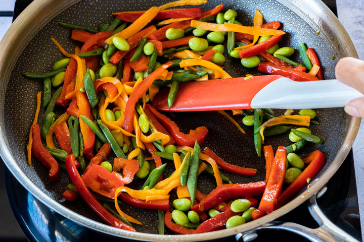 Cooking colorful stir-fry on the pan