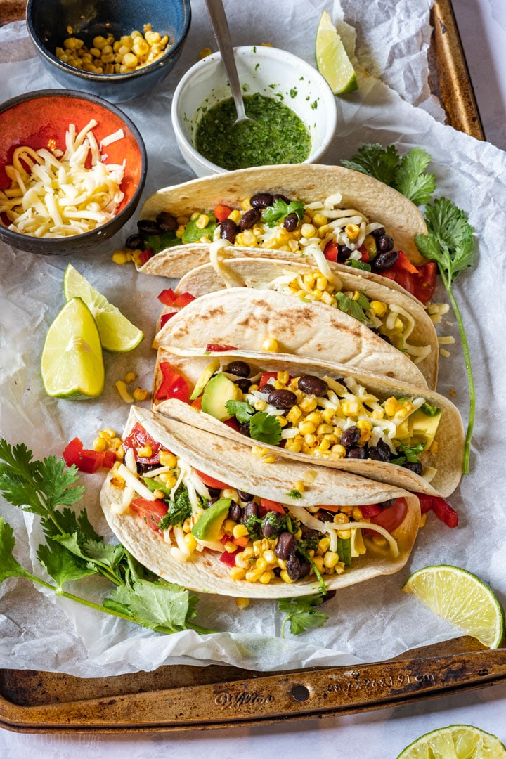 Vegetarian tacos with colorfull fillings and salsa